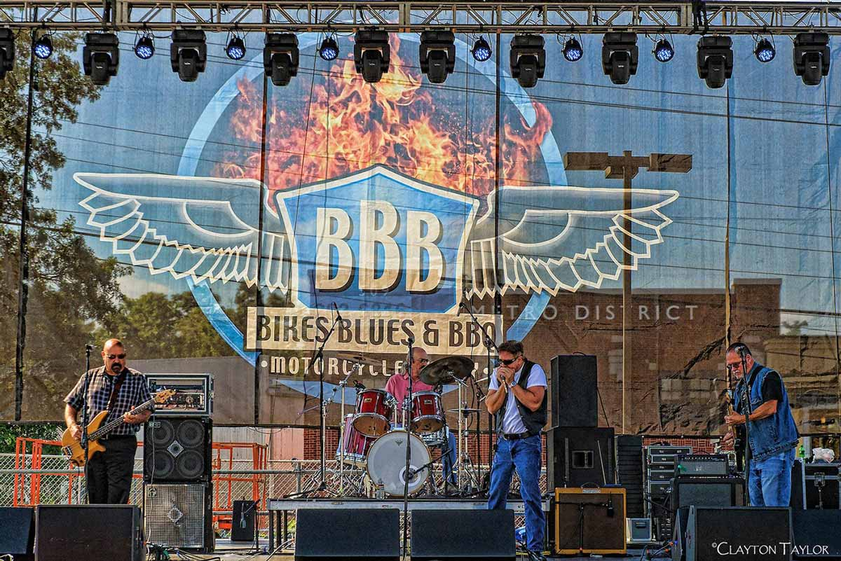 A band performs during the Bikes, Blues, and BBQ Rally