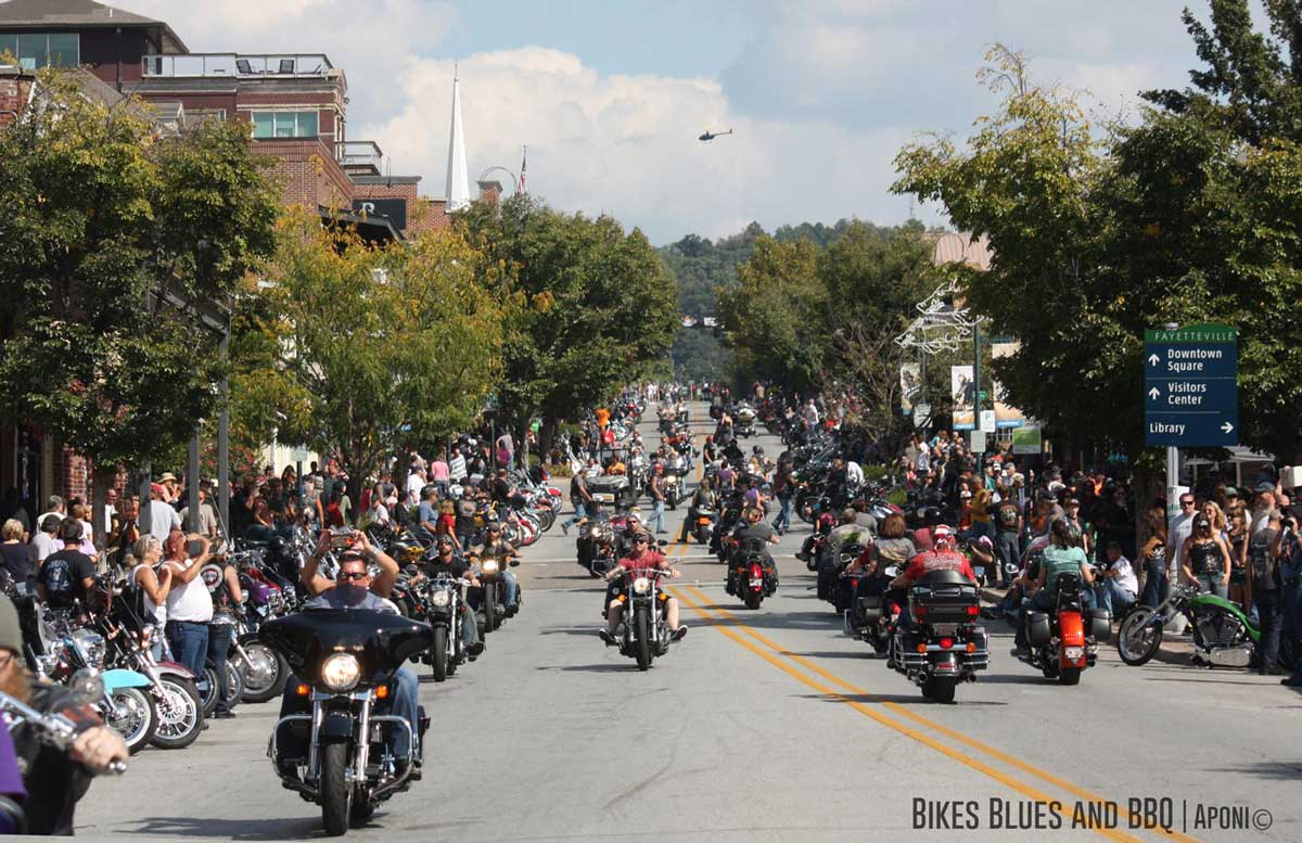 Motorcycles drive down Dickson Street during the Bikes, Blues, and BBQ Rally