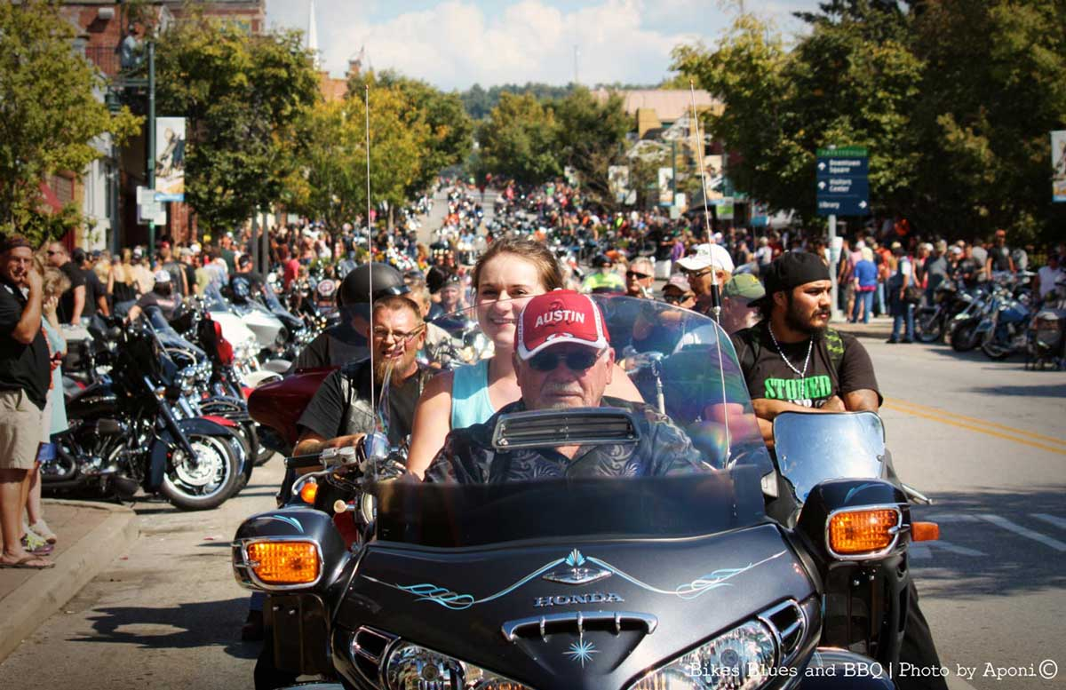 A man driving a motorcycle during the Bikes, Blues, and BBQ Rally